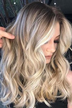 Cool Blonde with Shadow Roots | Sunkissed shades for your brightest summer ever. This season, hair colorists are picking up on hints that low-maintenance color is key. Between beach trips, far-flung adventures abroad and weekends spent honoring an ever-growing social calendar (hello, wedding season!), opportunities for touch-up sessions can come few and far between. Thankfully, you needn't play it safe on your hair color this season merely for the sake of time. #weddingmakeupandhair