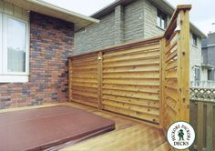 This privacy screen is made with 5\4 X 6 cedar boards angled to give a louvered look. This type of screen allows air to move through