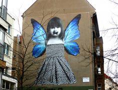 """Butterfly"" by Michele Tombolini in Friedrichshain, Berlin. The mural was done to raise awareness of child prostitution. #streetart #Berlin #friedrichshain"