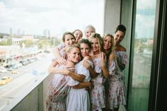 Bridesmaid love! Robes are the best! www.lovemeknotweddings.com/katiandbrandon Venue: South Congress Hotel Photographer: Tim Waters Photography Floral: Stems Floral Hair/Makeup: Kristin Karr & Lauren Davis Cake/Desserts: Nothing Bundt Cakes & South Congress Hotel DJ: Live Oak DJ, David Miranda Rentals: Marquee & Premiere Catering: South Congress Hotel