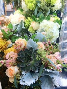 Texas Wedding Centerpieces featuring succulents, peach roses, dusty miller, and varying shades of hydrangea. Country chic. #love #dallaswedding www.drdelphinium.com