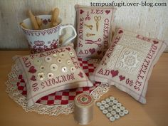 Pincushions with antique lace and buttons, by Tempus fugit