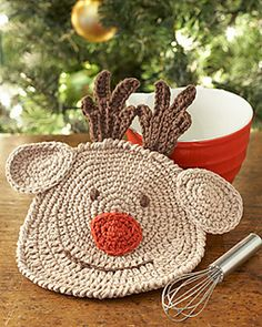 Rudolph the red-nosed dishcloth is here to help fill your kitchen with holiday cheer!