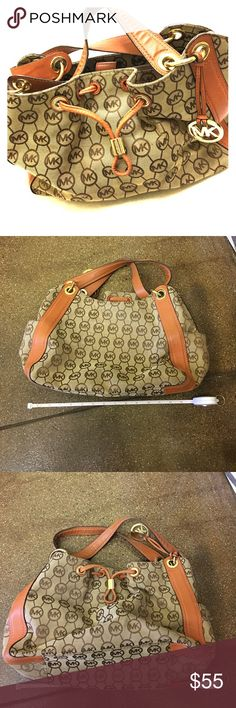 "Michael Kors hobo bag whisky color and brown Michael Kors hobo bag whisky color and brown monogram leather part has some fade to the leather still in good condition very roomy inside zipper and pockets measures 14""x8"" Michael Kors Bags Hobos"