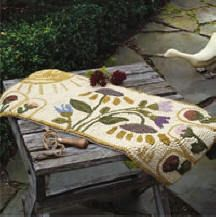 Flowers and sun hooked rug on light background