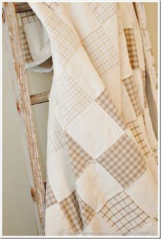 Brown and cream patchwork quilt.  I like the gingham and plaids.