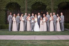 Light pink bridesmaid dress accented by grey tuxedos for the groomsmen | villasiena.cc