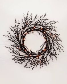 Create an elevated Halloween scene with handcrafted branches dipped in black glitter. Wreaths And Garlands, Outdoor Wreaths, Halloween Scene, Halloween Season, Tree Decorations, Halloween Decorations, Orange Led Lights, Slim Tree, Balsam Hill