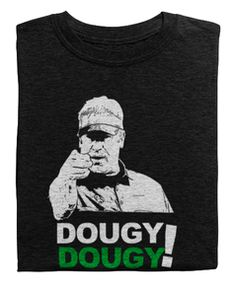 Our coach, our leader, our guy! Get your Dougy on today!     *The heather black MAY run a tad small - Order a size up for a looser fit!  100% combed ring-spun cotton* Fabric weight: 4.3 oz (146 g/m2) Pre-shrunk Tear-away label