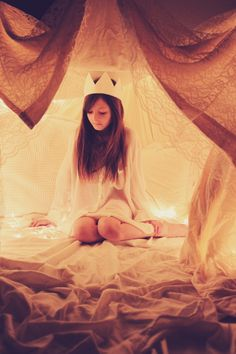 build a fort with sheets and string lights for kids to play