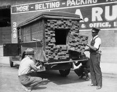 What appeared to be an innocent truckload of lumber, turned out to be a bootlegger's vehicle loaded with prime scotch when the Los Angeles Federal Prohibition Agents smelled the odor of a broken bottle. Investigation disclosed a cleverly conceales trapdoor of board ends leading to the interior, from which 70 cases of liquor were taken. The device is said to be the most ingenious ever caught here. (10/23/1926)