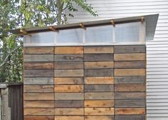 [modern] shed plans. I like the recycled boards cut in short lengths pictured here. They might have been scraps from a bigger project.