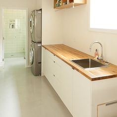 I like the butcher block countertop. Laundry Photos Powder Room