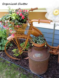 Newly Planted Annuals in Vintage Bike Basket www.organizedclutterqueen.blogspot.com