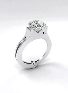 Handcuff engagement ring. Cute!!!