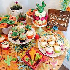 "BABY SHOWER~ Fiesta themed, Yes those are tacos on the cupcakes & Mexican blankets & cactus donuts & cactus shaped macaroons & cactus cupcakes. blew it out of the water for this fiesta! Adorable ""taco'bout delicious"" sign by too good! Mexican Fiesta Party, Fiesta Theme Party, Taco Party, Mexican Birthday, 2nd Birthday, Cactus Cupcakes, Tacos And Tequila, Fiestas Party, Party Time"