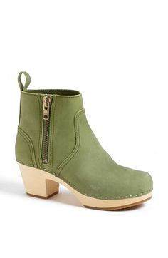 Free shipping and returns on Swedish Hasbeens 'Emy' Bootie at Nordstrom.com. Go for retro flair with a kicky zip bootie inspired by '70s Swedish fashion. The ergonomic sole is crafted from a single piece of seasoned lime wood, a soft but strong material.