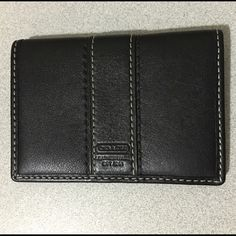 """Coach Leather Card Case Authentic classic Coach black leather card case.  Great condition!  Interior has 2 credit card slots, a see thru window ID slot and 2 other slots behind the ID and credit card slots.  Back of case has a see thru window ID slot and a slot behind it.  No trades.  Make offer using """"offer"""" feature.  Thanks for looking! Coach Bags Wallets"""