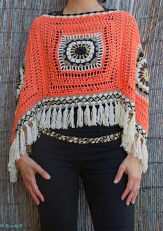 Bo-M - Love this! 4 granny squares and fringe. There's a purse very similar but has 6 small grannies & fringe.