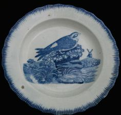 "Pearlware 4.5 inch child's plate with a shell edge, ca. 1820. The bird is a martin or window swallow. The image was copied from Thomas Bewick's 1797 ""A History of British Birds: Volume I. Land Birds."" See www.transcollectorsclub.org"