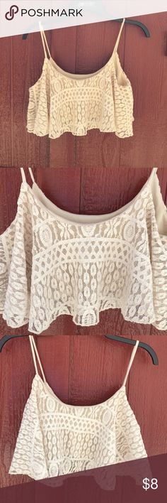 Half Top Lace Lined with elastic on the bottom super flows with lace detail. Can't read the tag but I think it's a small. No snags or stains Tops Tank Tops