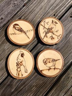 Original wood burned set of 4 coasters. Featured birds: cardinal, blue jay, chickadee, and finch. Other birds can be substituted upon request.  Coasters are coated with a natural protective finish.  Diameter is about 3-4