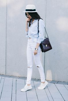 Summer Fashion | What to Wear With White Jeans - Classic button-down shirt, boxy bag, sneakers, and cool white summer-y hat @stylecaster