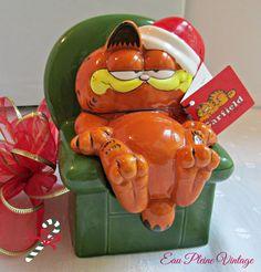 Garfield the Christmas Cat.  https://www.etsy.com/listing/243981778/garfield-nos-christmas-xmas-ceramic-bank