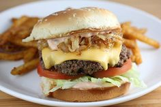 Who doesn't love a good burger? This Copycat Outback Steakhouse Bloomin' Burger Recipe makes an amazing dinner that you whole family will love. What makes this particular Outback Steakhouse copycat recipe so unique is the bloomin' onion strips. Hamburger Buns, Hamburger Recipes, Beef Recipes, Cooking Recipes, Healthy Recipes, Griddle Recipes, Family Recipes, Easy Cooking, Easy Recipes