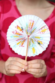 These fans fold up & store perfectly in a pocket for hot days. Decorate the front with pictures & secure with popsicle sticks & a rubber band!The girls and I had fun making these littl…