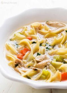 The BEST homemade chicken noodle soup! Made from scratch, light and nourishing. All the goodness from the chicken in one pot of soup. Just what you need to recover from a cold or the flu. On SimplyRecipes.com #ChickenSoup #ChickenNoodleSoup #Soup #ColdRemedy