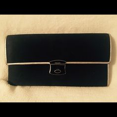 Authentic Prada Wallet Nylon wallet trimmed in silver leather. Has the authenticity certificate card. Nice wallet. The snap is broken so it won't close. Priced super low because of the broken snap. Trim has some very minor signs of wear. Good condition! Cute! Prada Bags Wallets