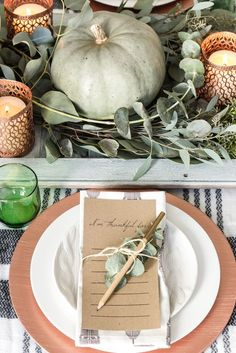 Green and Copper Thanksgiving Tablescape + Printable | blesserhouse.com - Spray paint dollar store votives with copper, use scarves as a tablecloth, and an old shutter as a runner! So cheap and easy!