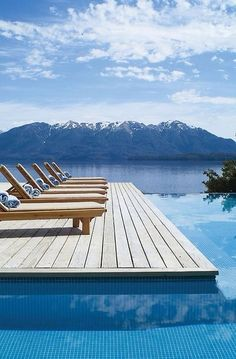 WOW! The clean lines of this swimming pool deck do a great job of  leading your eye out to this spectacular view.
