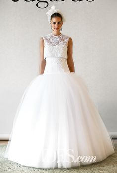 "Brides.com: . ""Diamond"" high neckline sleeveless lace and tulle ball gown wedding dress with a dropped waist, Edgardo Bonilla"