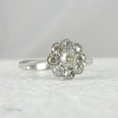 Art Deco Diamond Daisy Engagement Ring. Old Mine Cut Diamonds in White Gold Cluster Flower Shape Ring, Circa 1930s.