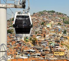 Gondola line above the favelas of Rio - just like in America where we build an expressway to go around the inner city.  Photo: André Gomes de Melo
