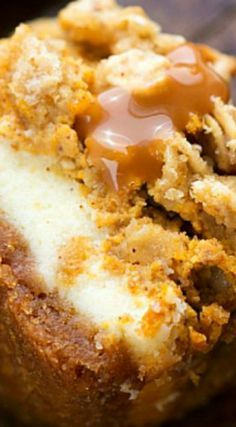 Pumpkin Caramel Cheesecake Bars with a Streusel Topping ~ Delicious... Two layers of cheesecake on a delicious cinnamon graham cracker crust all topped with an easy streusel and caramel sauce.
