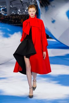 Dior Fall 2013. A shape in the front of the gown shows a triangular volume like and egyptian apron would have.