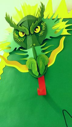 Maverick Dragons Bulletin Board. This intimidating Dragon was made from cardboard, paper and hot glue.