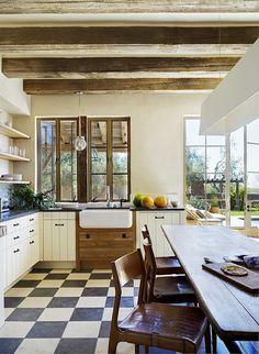 Farmhouse sink, exposed beams, & checkered floors  ❤