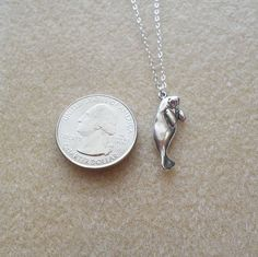 Or this tiny, precious silver necklace. | 19 Incredibly Cute Products For Everyone Who Loves Manatees