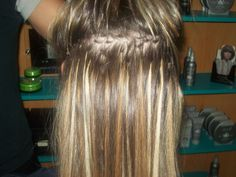 This is an example of fusion extensions. I picked it because you can see the natural (neutral brown) hair and the fusion ad ins which look platinum and honey blonde. Fusion extensions are done by using a variety of methods. Some use keratin glue. The hair comes pre-tipped with the glue and a heating appliance warms up the glue and the extension is bonded to the person's natural hair, close to the scalp. Other methods use O-rings which are flattened with pliers.