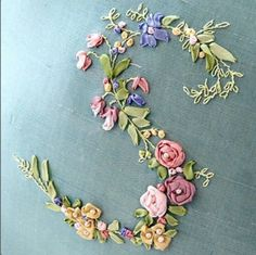 Gave me an idea to place silk flowers in an m shape, sew/glue them to burlap, and frame. To-do