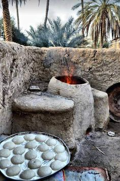 Clay Tanoor bread Tanoor mean something like over but made from clay &putting woods in front of it then bake the bread . Very tasty just from Iraq Village Scene Drawing, Iraqi People, Baghdad Iraq, Cradle Of Civilization, Bagdad, Painting Of Girl, Arabic Art, Naan, Beautiful Places To Visit