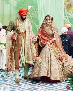 Beautiful Indian bride in grey maroon Rimple Harpreet Wedding Lehenga. There are different rumors about the real history of … Indian Bridal Outfits, Indian Bridal Lehenga, Indian Bridal Wear, Bridal Dresses, Indian Dresses, Indian Wear, Indian Clothes, Wedding Lehnga, Sikh Wedding