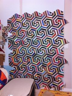pieced triangles , careful placement of values in order to get wonky spiral effect
