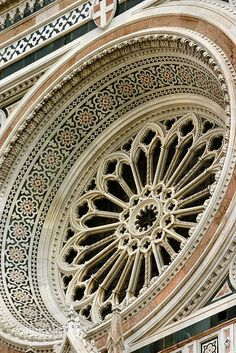 Il Duomo, Florence, Tuscany Region, Italy.  The Basilica di Santa Maria del Fiore (English: Basilica of Saint Mary of the Flower) is the main church of Florence, Italy.  The cathedral is the mother church of the Roman Catholic Archdiocese of Florence.  The church is particularly notable for its 44 stained glass windows, the largest undertaking of this kind in Italy in the 14th and 15th century.