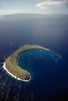 Molokini Crater - located off the shores of Maui in Hawaii's Maui County. 23-acre crescent-shaped island is a volcanic crater.