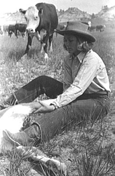 cowgirl roping or branding cattle - Helped out with alot of these!